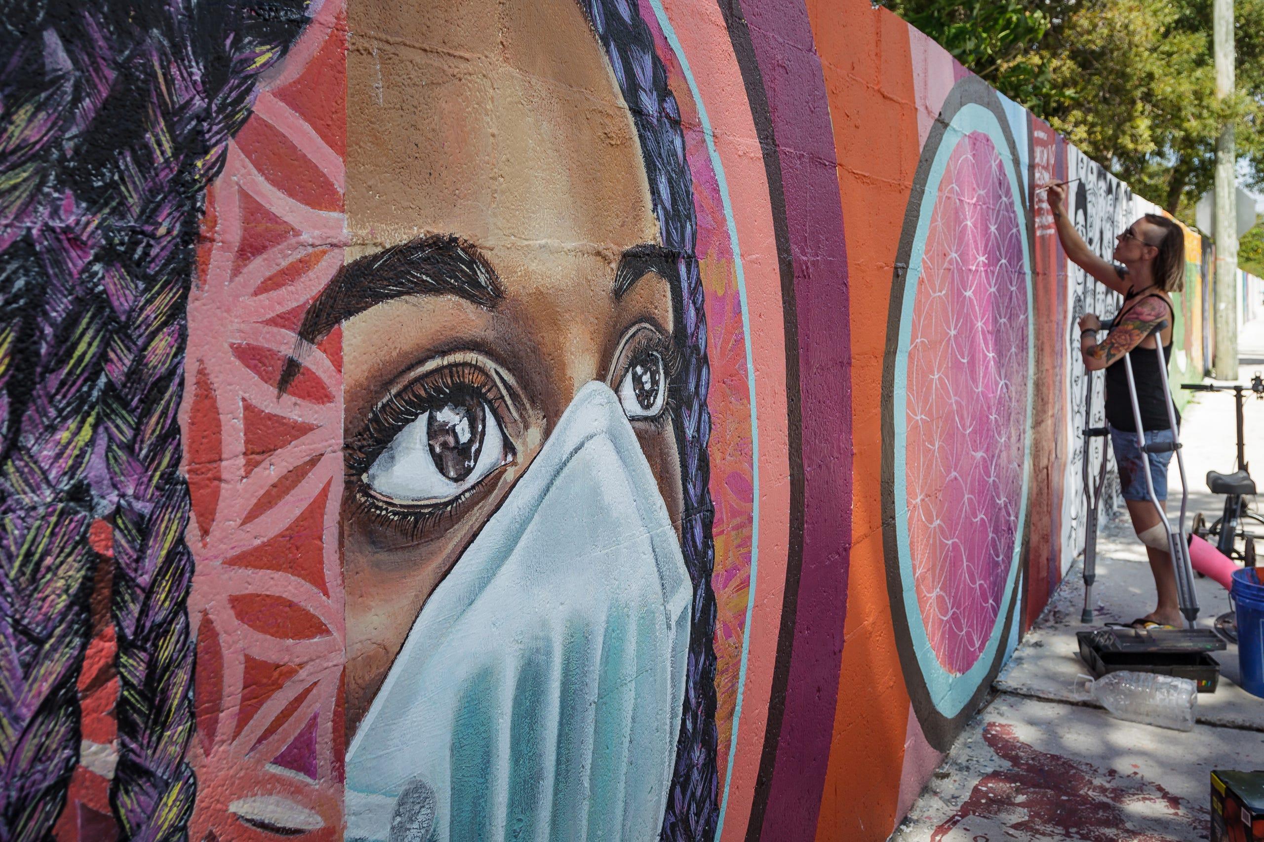 Artist Lindsay McGlynn Paints A Mural On the Lake Worth Beach Unity Wall