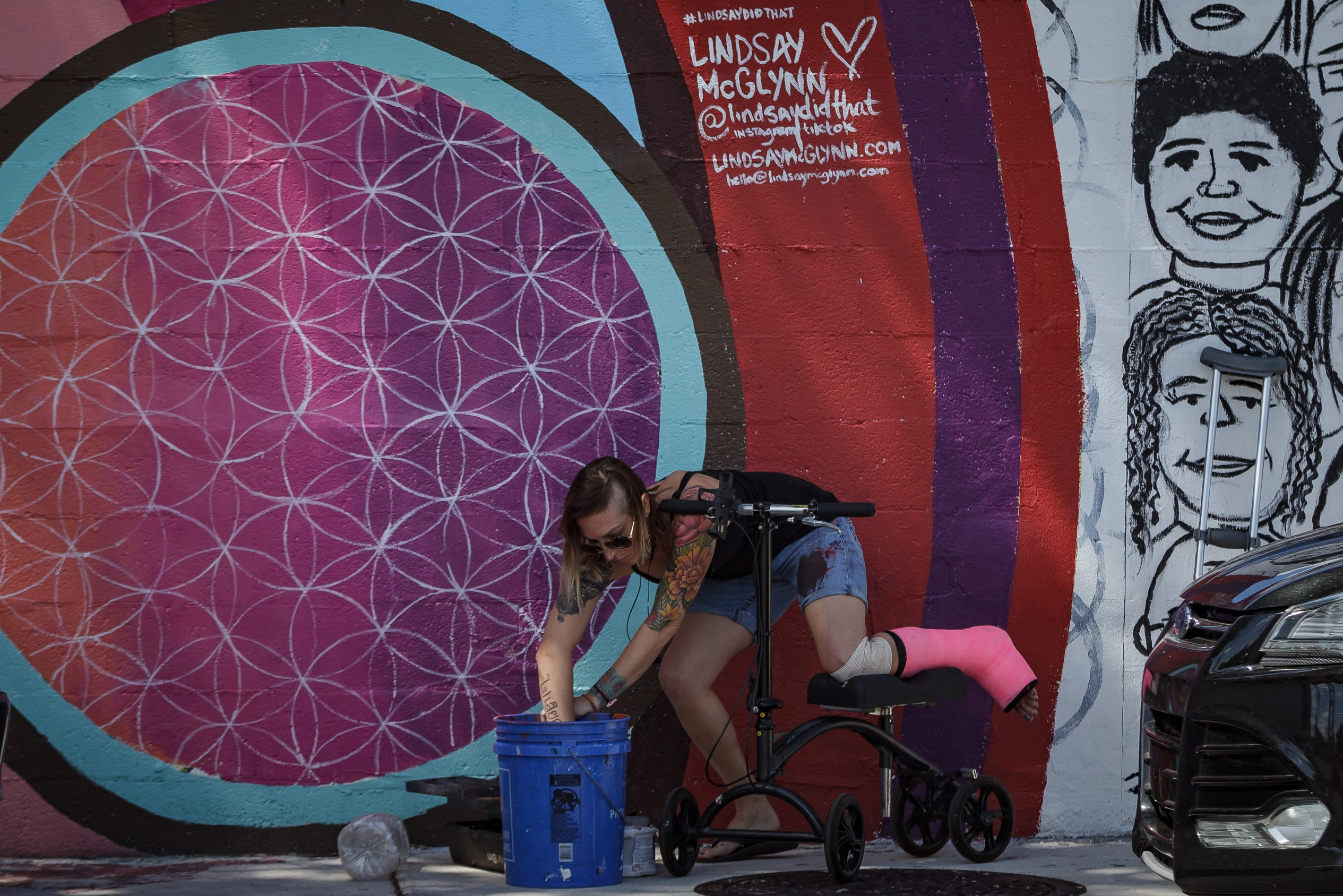 Artist Lindsay McGlynn Paints A Mural After Ankle Surgery